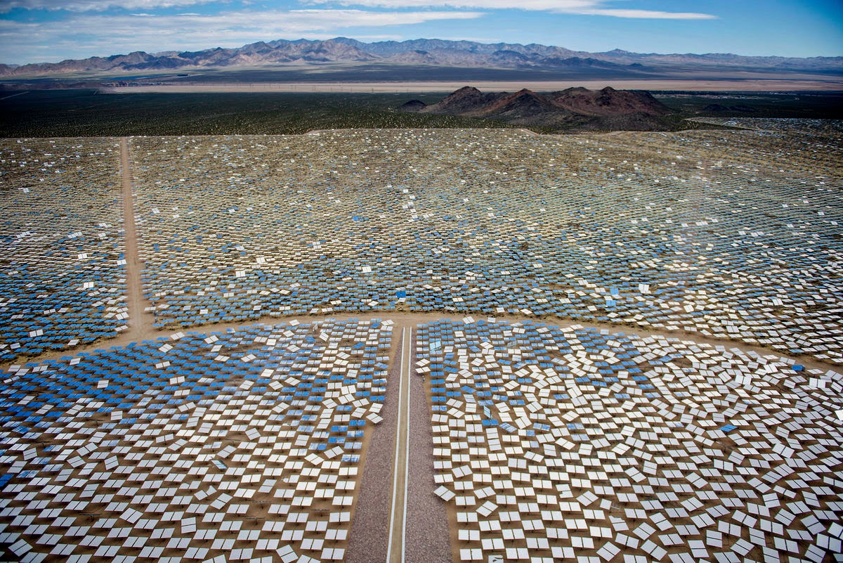 """Solar panels stand at the Ivanpah Solar Electric Generating System in the Mojave Desert near Primm, Nevada, U.S. """"We need the largest financial players in the world to engage in the climate debate as an economic imperative"""". (Credit: Jacob Kepler/Bloomberg) Click to Enlarge."""