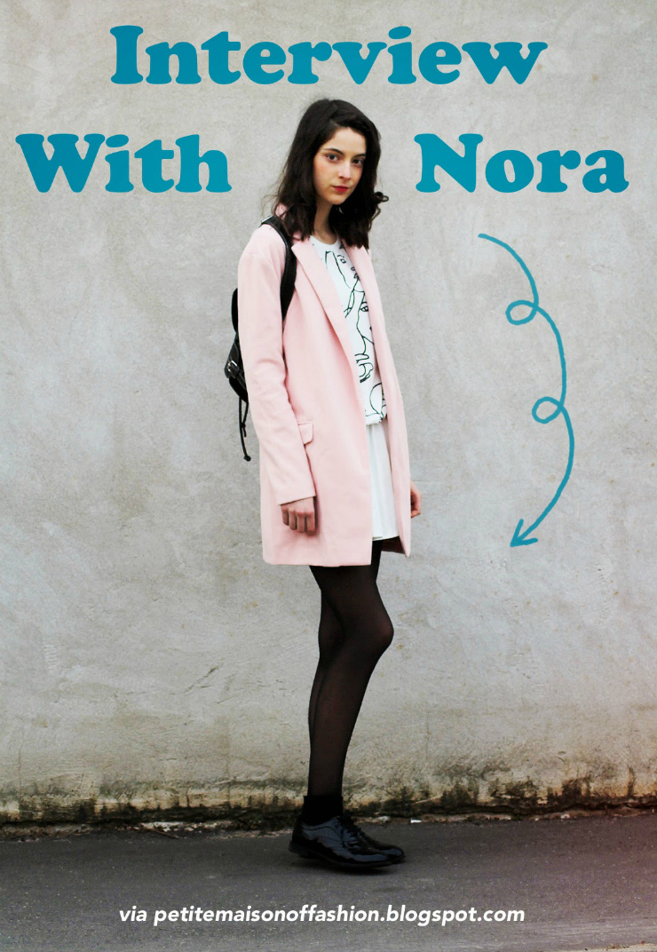 Nora, fashion blogger, wears a cute pastel winter coat