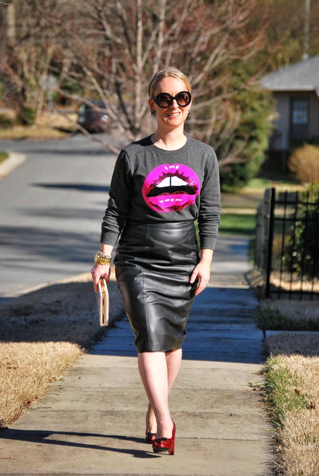leather pencil skirt, pink pumps, Kate Spade book clutch
