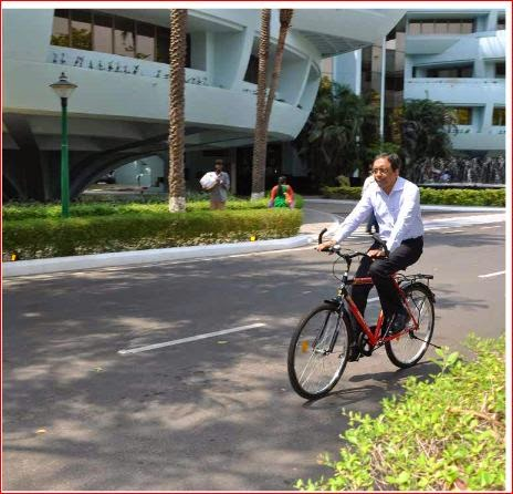 SN Subrahmanya, EVP of Larsen & Toubro on a bike in their Chennai campus