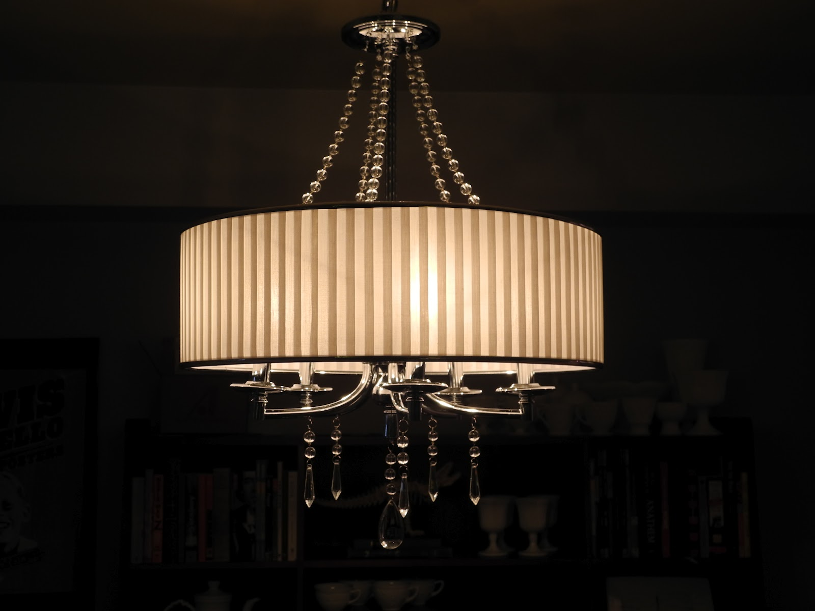 Librarian tells all echelon by golden lighting the for Modern crystal chandelier for dining room