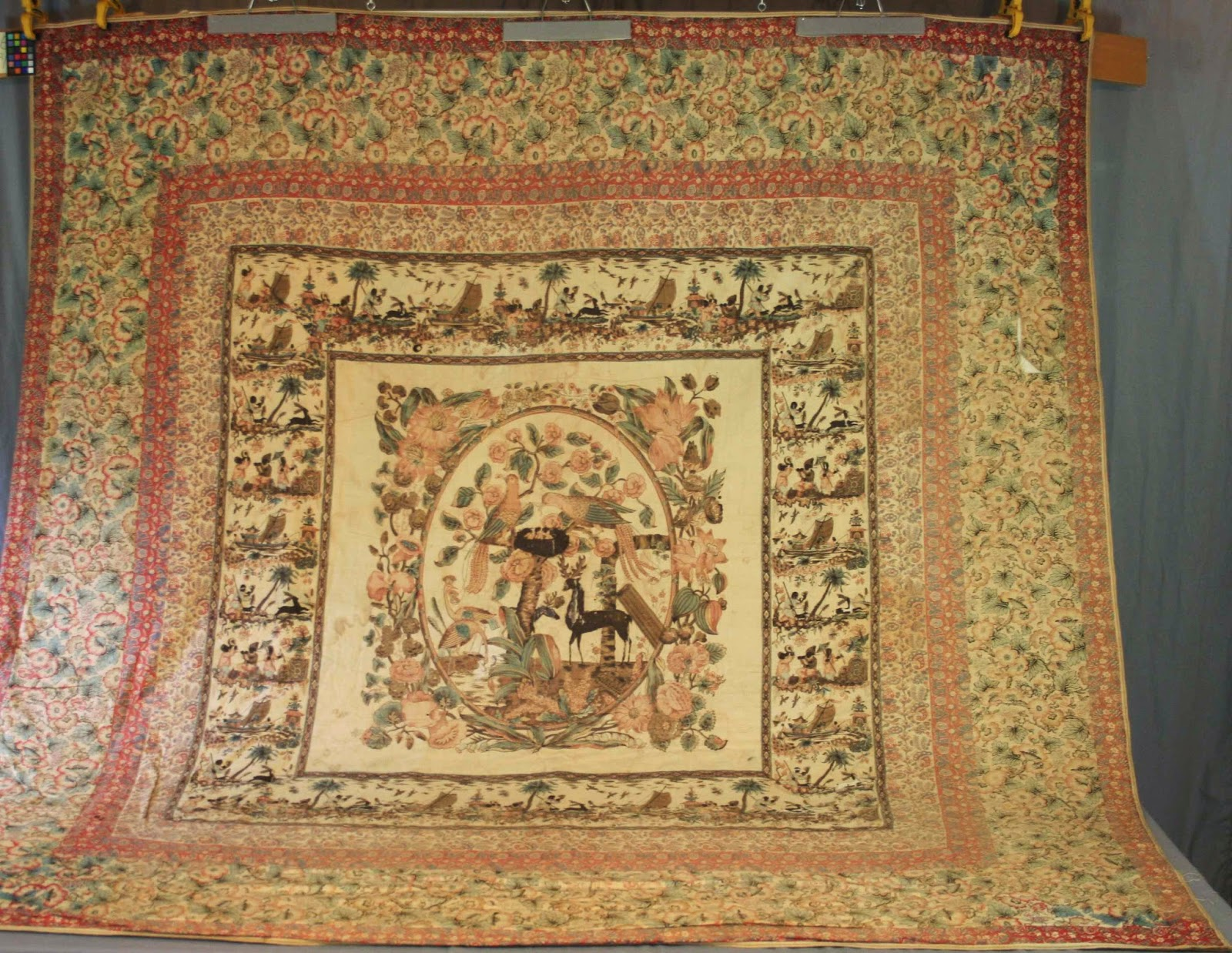 Palampore before treatment at Spicer Art Conservation. Textile conservator