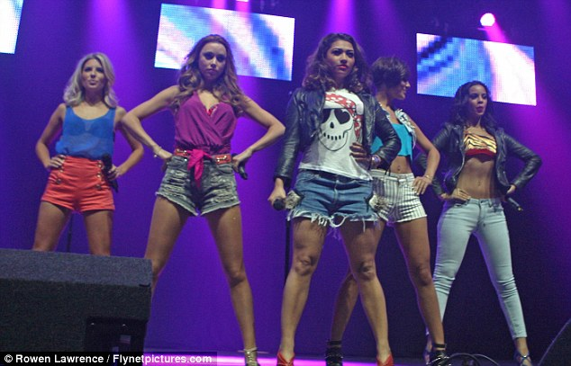 Keeping it brief: The Saturdays play live in tiny shorts as Nicola Roberts gets over nerves to make solo onstage debut