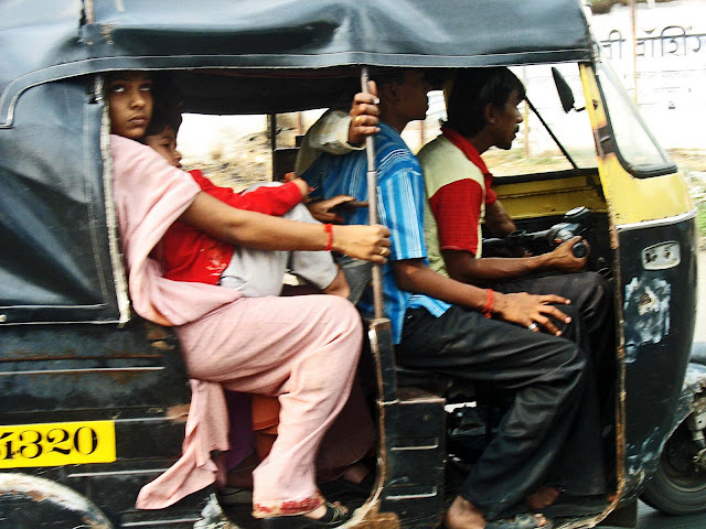 autorickshaw crammed with people