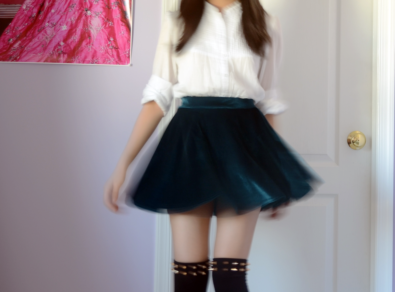 Fashion photo featuring soft teal velvet skater skirt, white shirt, and black knee high socks