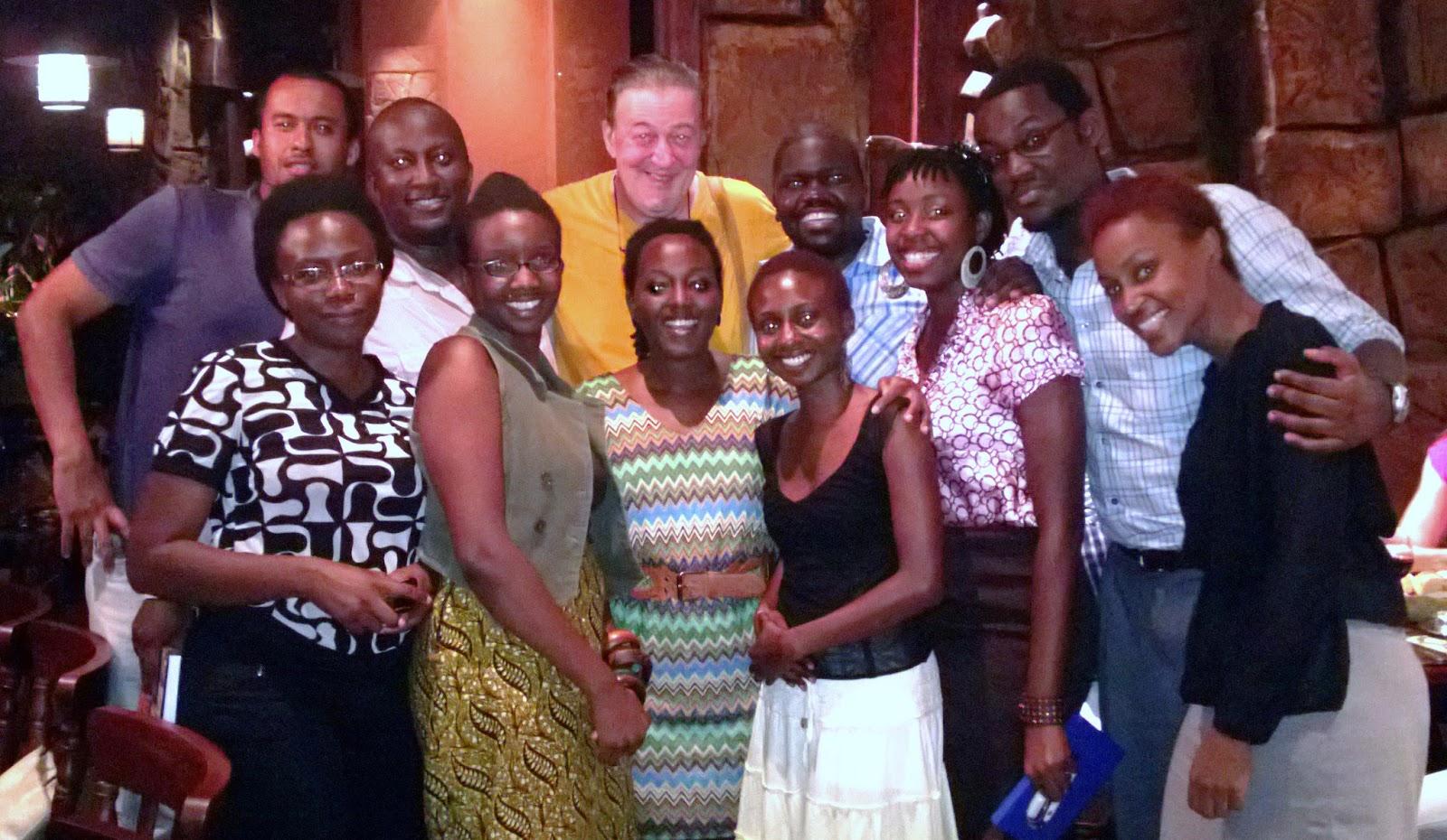 http://4.bp.blogspot.com/-dRIgGf4XnhI/USPgBiQ7ogI/AAAAAAAAIRM/wkaRCcypmvY/s1600/stephen+fry+with+ugandans.jpg