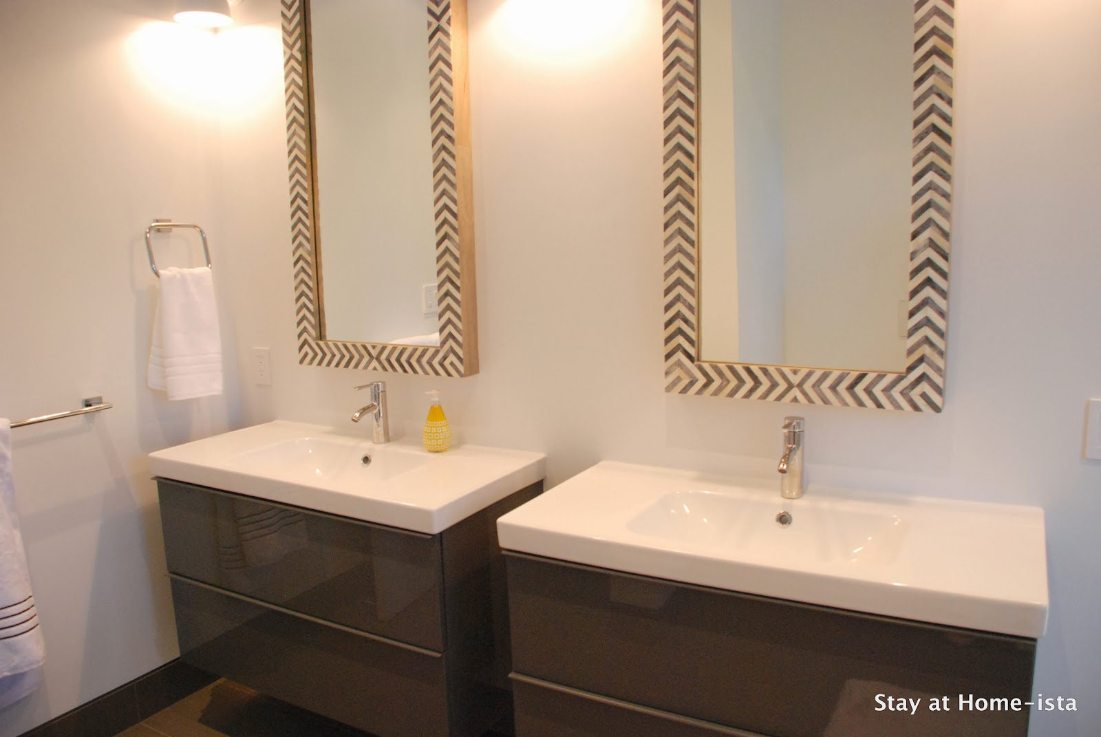 Amazing Herringbone vanity mirrors over Ikea vanities