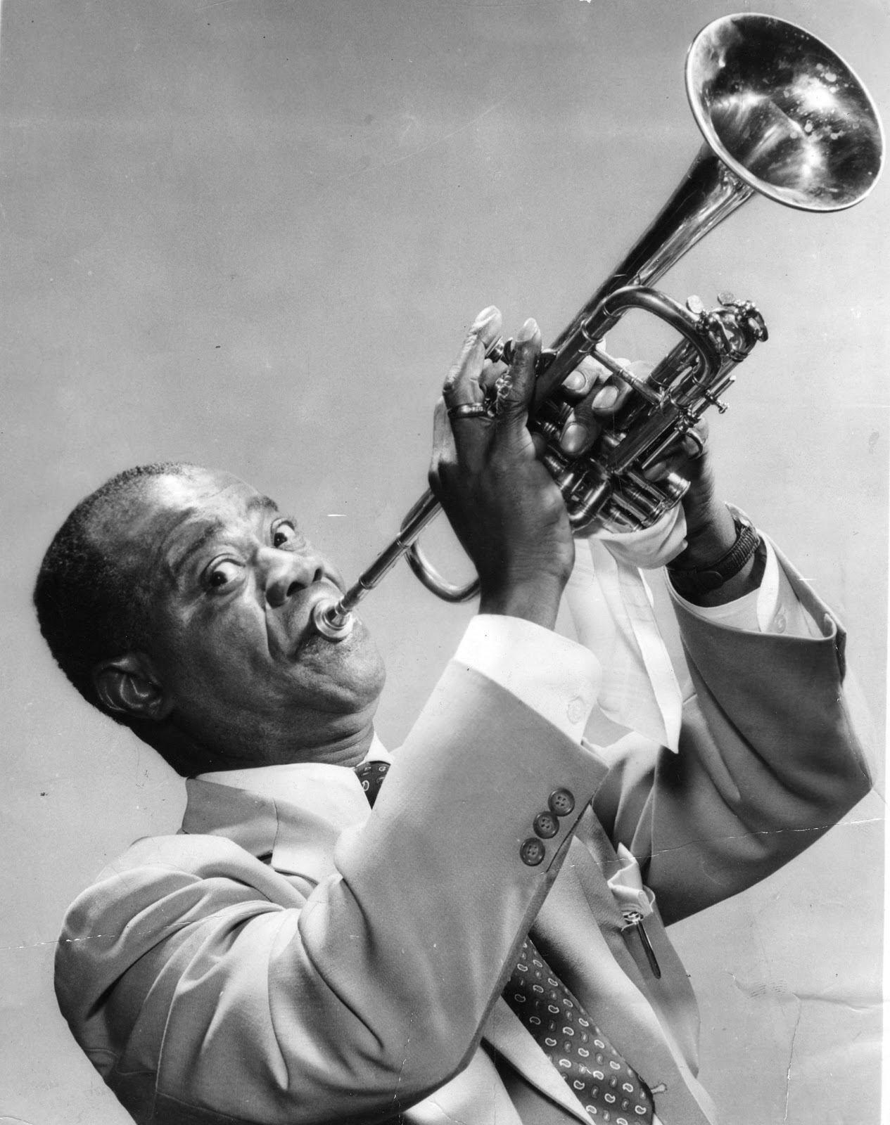 the life and career of louis armstrong Louis armstrong short-haired black man in his fifties blowing into a trumpet ^ synopsis: jazz trumpeter and singer louis armstrong is the star of a rhapsody in black and blue, one of.