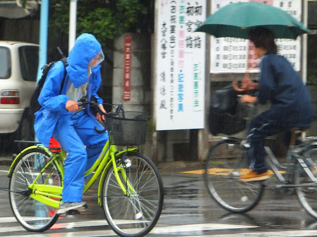 Cyclists battling the elements in Tokyo.