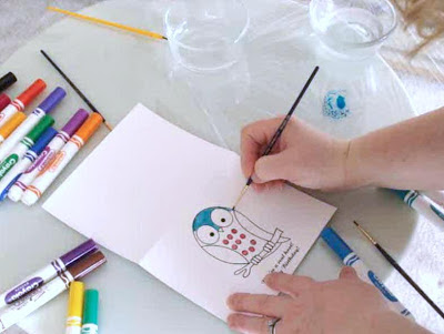 paint artwork with a wet paintbrush and ink from a washable marker