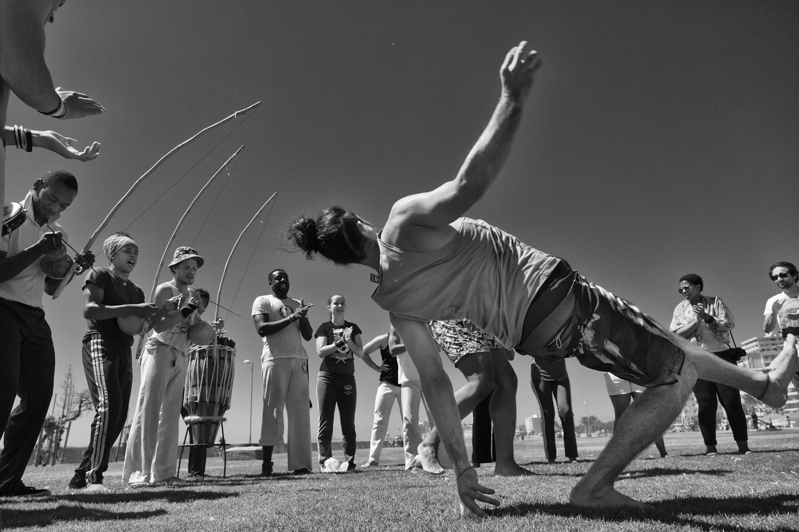 A man dances in a Brazilian martial art