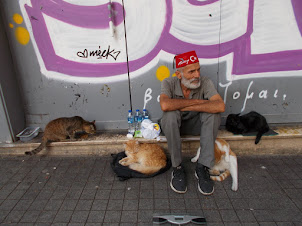 """The """"Cat-Man"""" of Istiklal street in Istanbul."""