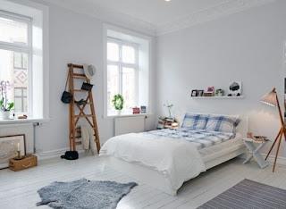cozy scandinavian bedrooms 46 554x405 Dekorasi kamar tidur untuk cuaca dingin