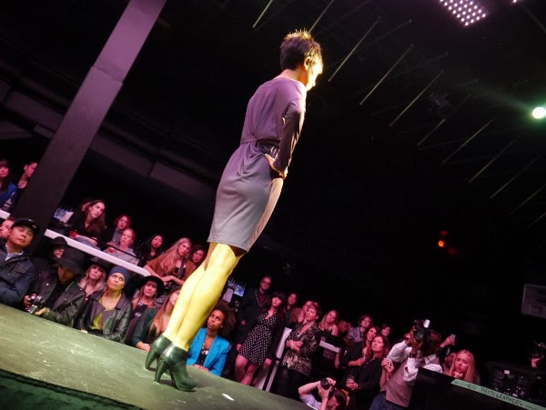 A knee-length, purple jersey dress by Nicole Bridger