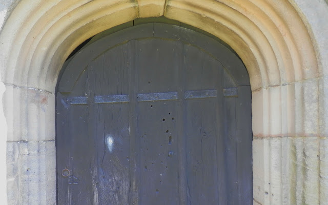 Doors to the tower at St. John The Baptist in Mayfield