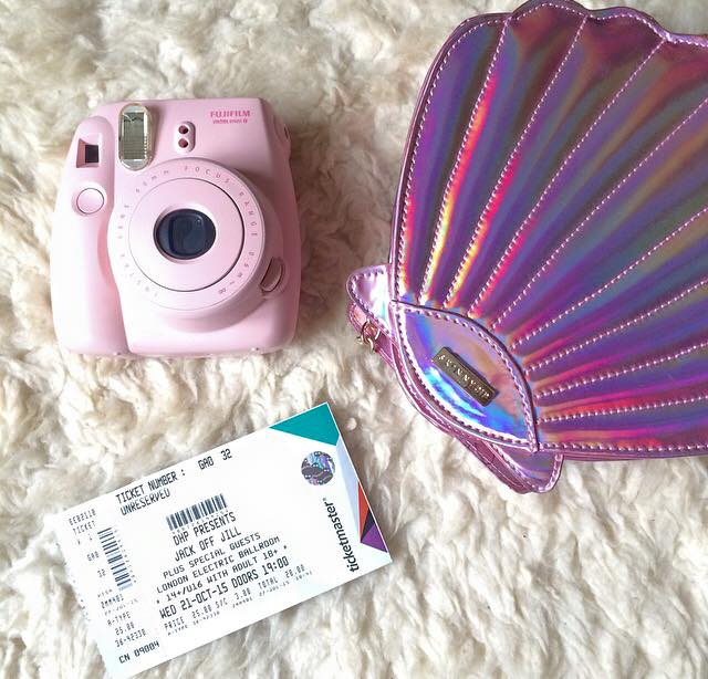 pink Instax and purple shell bag
