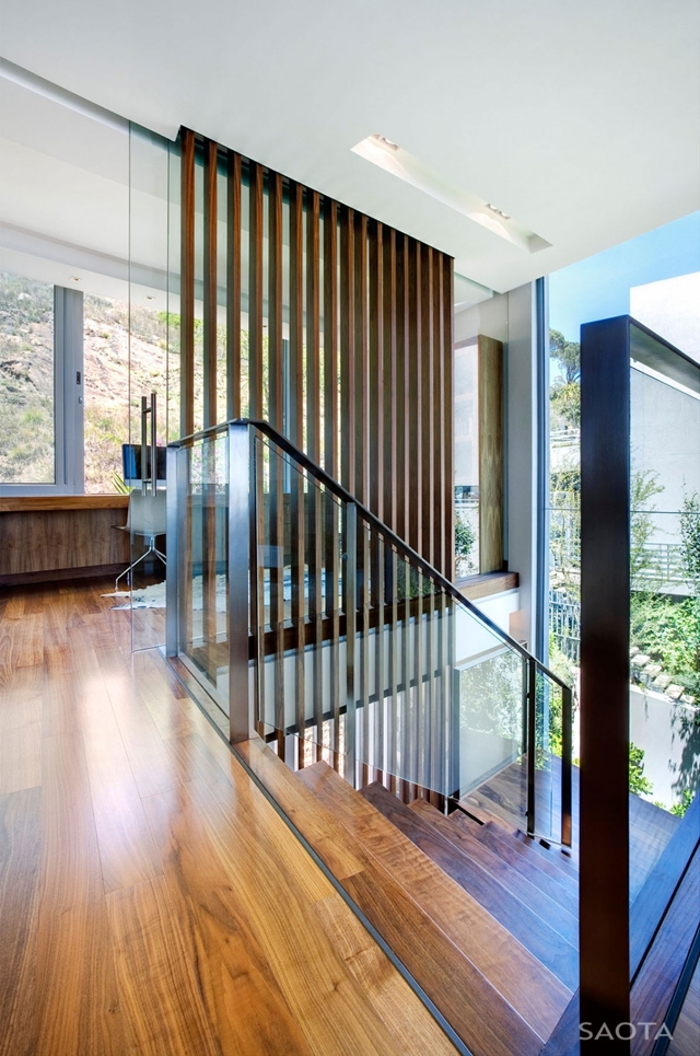 Glass and wood railing on the upper floor