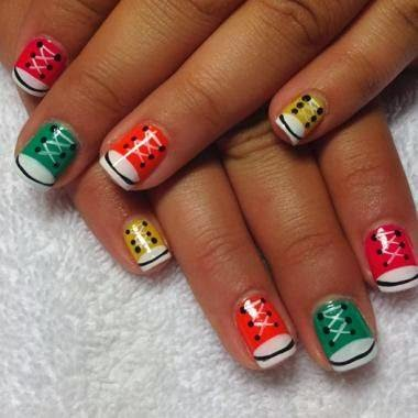 Red, orange, yellow and green gel-color design on natural nails with a normal manicure