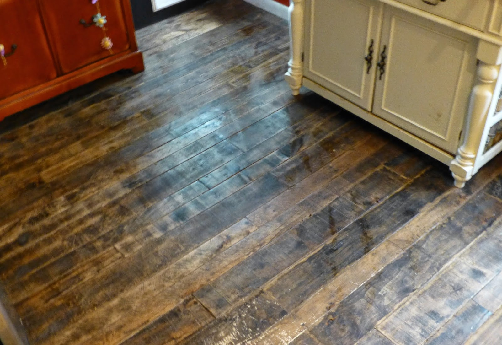 Barnwood and bangles reclaimed wood kitchen floor for Reclaimed flooring