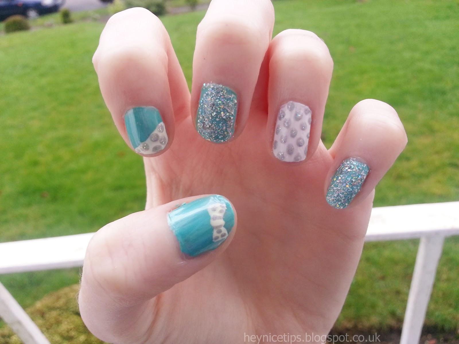 hey nice tips blue sparkle bow nails
