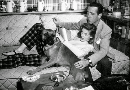 Humphrey Bogart and Lauren Bacall relaxing at home.