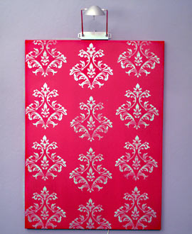 Hang stenciled canvas on the wall
