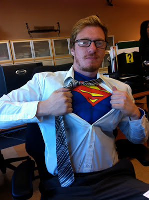 Man dressed in Clark Kent/Superman Costume