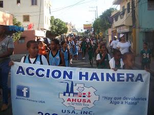 Acción Hainera USA entrega asfaltado de cancha Club Centro Haina