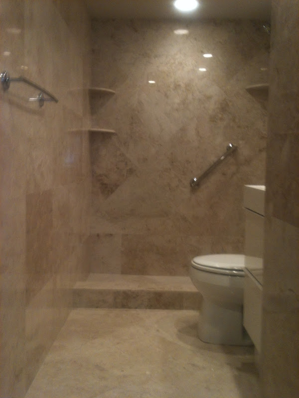 The Material used in the Master Bathroom is Capuccino Marble 18