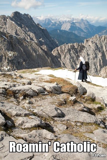 Nun hiking in the alps