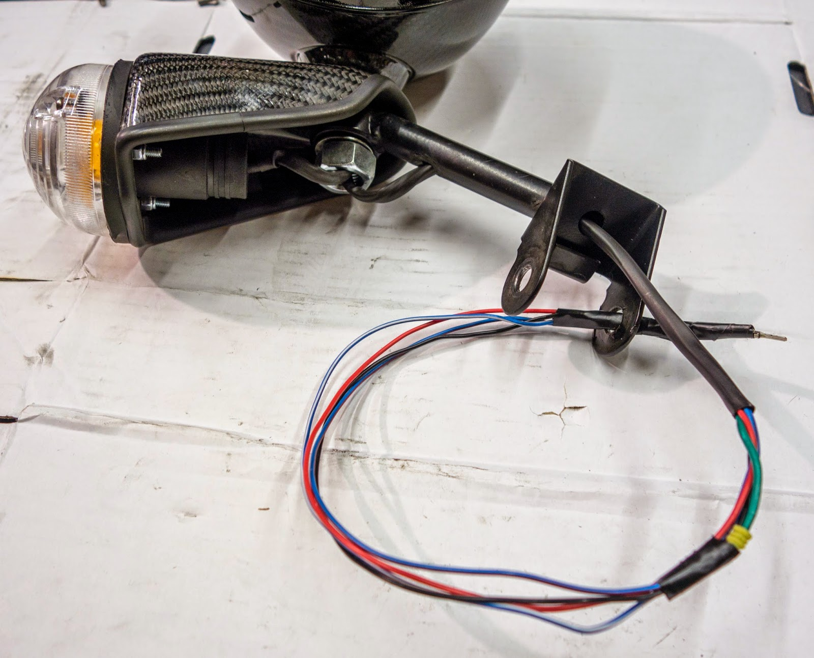 Wiring fed through headlight mounting bracket
