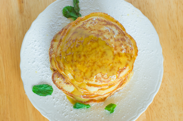 Lemon Pancakes with Mint Custard Sauce | thumb in plum