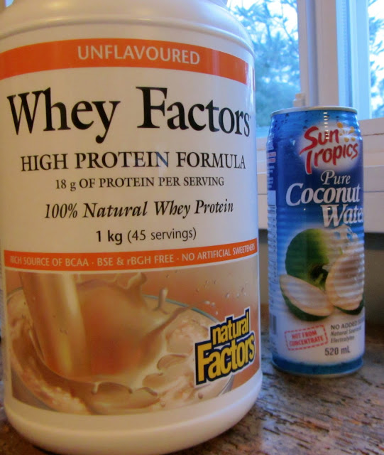 whey factors and coconut water can on a counter