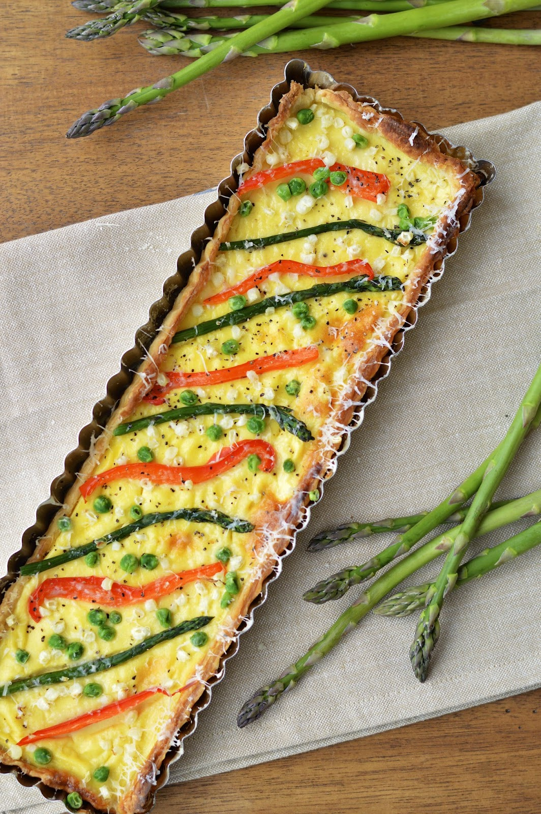 This spring vegetable tart is made with greek yogurt and fresh veggies. It's perfect for dinner with crusty French bread and an arugula salad | Virtually Homemade
