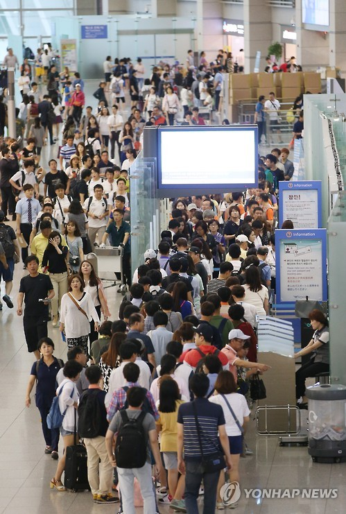 Aeropuerto de Incheon abarrotado de viajeros