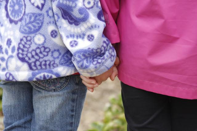 little girls holding hands