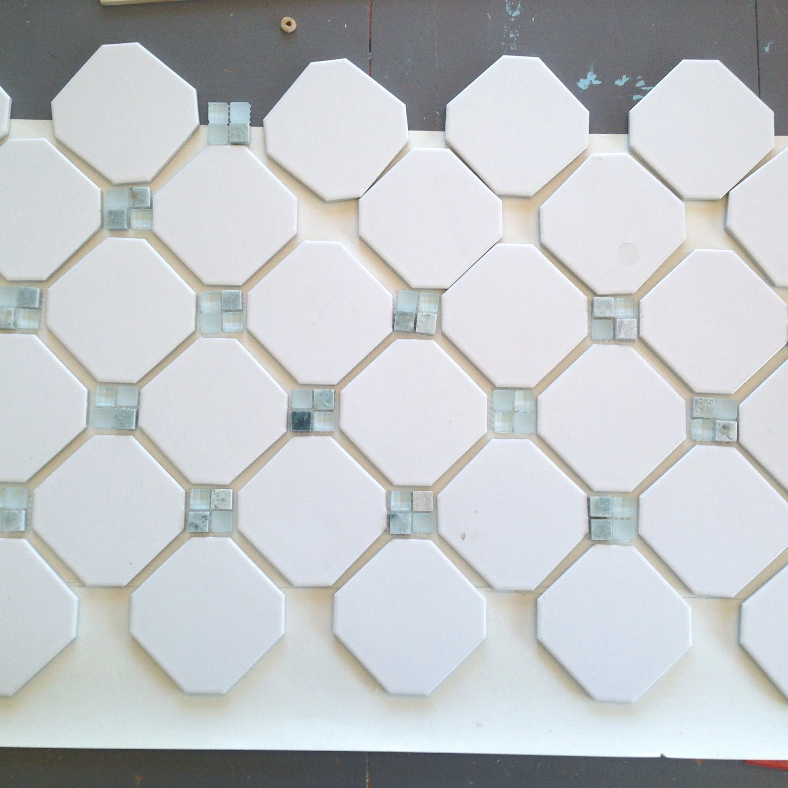Fireplace makeover octagon dot tile averie lane fireplace laying out an octagon and dot pattern white matte finish octagon tile and natural stone dailygadgetfo Gallery