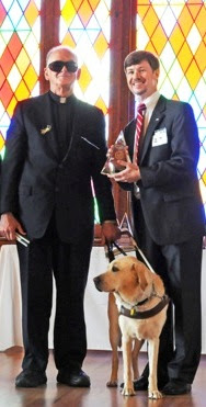 Father Pat with Golden Retriever Guide Dog