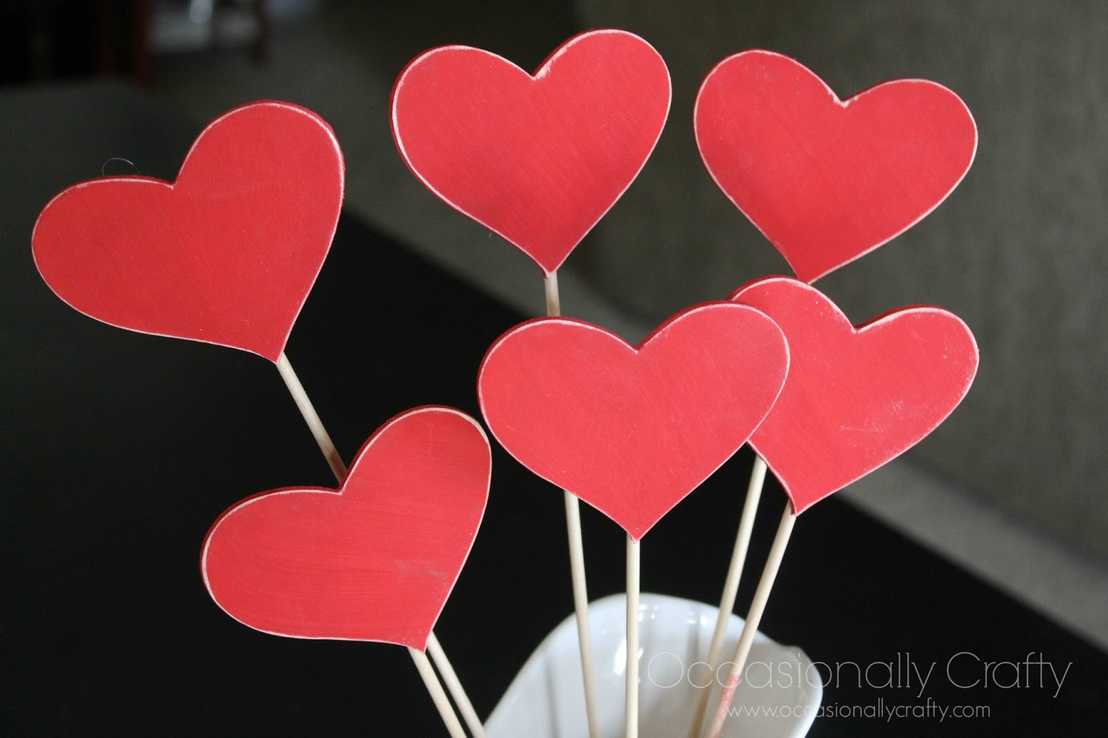 i put mine in a white pitcher vase filled with dry beans so the skewers will stay in place there you go a quick and easy valentines day decoration - Valentines Day Decor