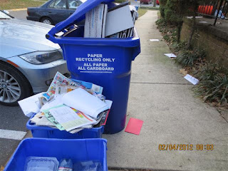 recycling bin overflowing with paper
