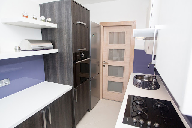 Picture of purple and black kitchen design