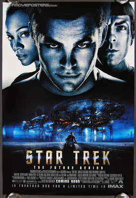 Movie poster showing Kirk, Spock and Uhura.
