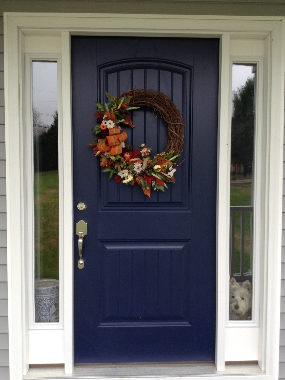 4 ashcrafts heres a picture of the fall wreath on the front door soon the christmas wreath will go up the door color is sherwin williams naval rubansaba