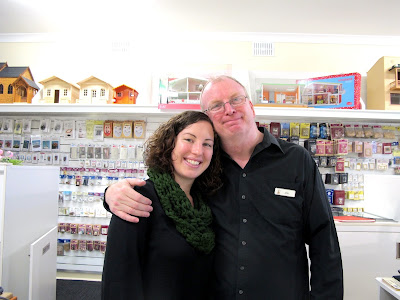 Fairy Meadow Miniatures' owner and daughter behind the counter at the new shop.