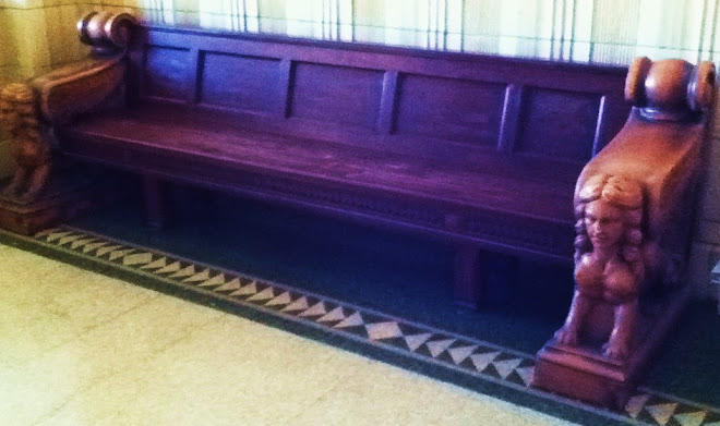 Atlas Building's carved wooden bench seat in Entrance