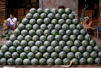 Filipino, Worker, Manila, New Year,  Belief, Practice, Display, News, Shaped, Fruit, Month, Prosperity, Shape, Round,  Pyramid, Market, Business, Economy, Food, Philippine, Philippines, Watermelon, Day, City,