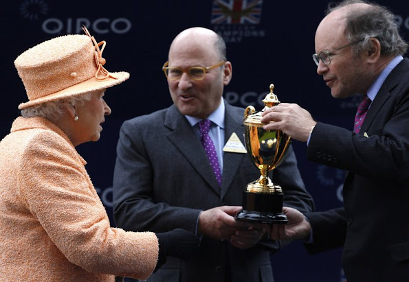 Queen Elizabeth II presents the trophy to owners Alain Wertheimer and Gerard Wertheimer, after their horse Solow won the Queen Elizabeth II Stakes Race