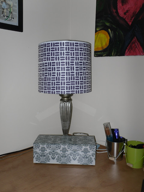 Stenciling is finished on lamp shade.