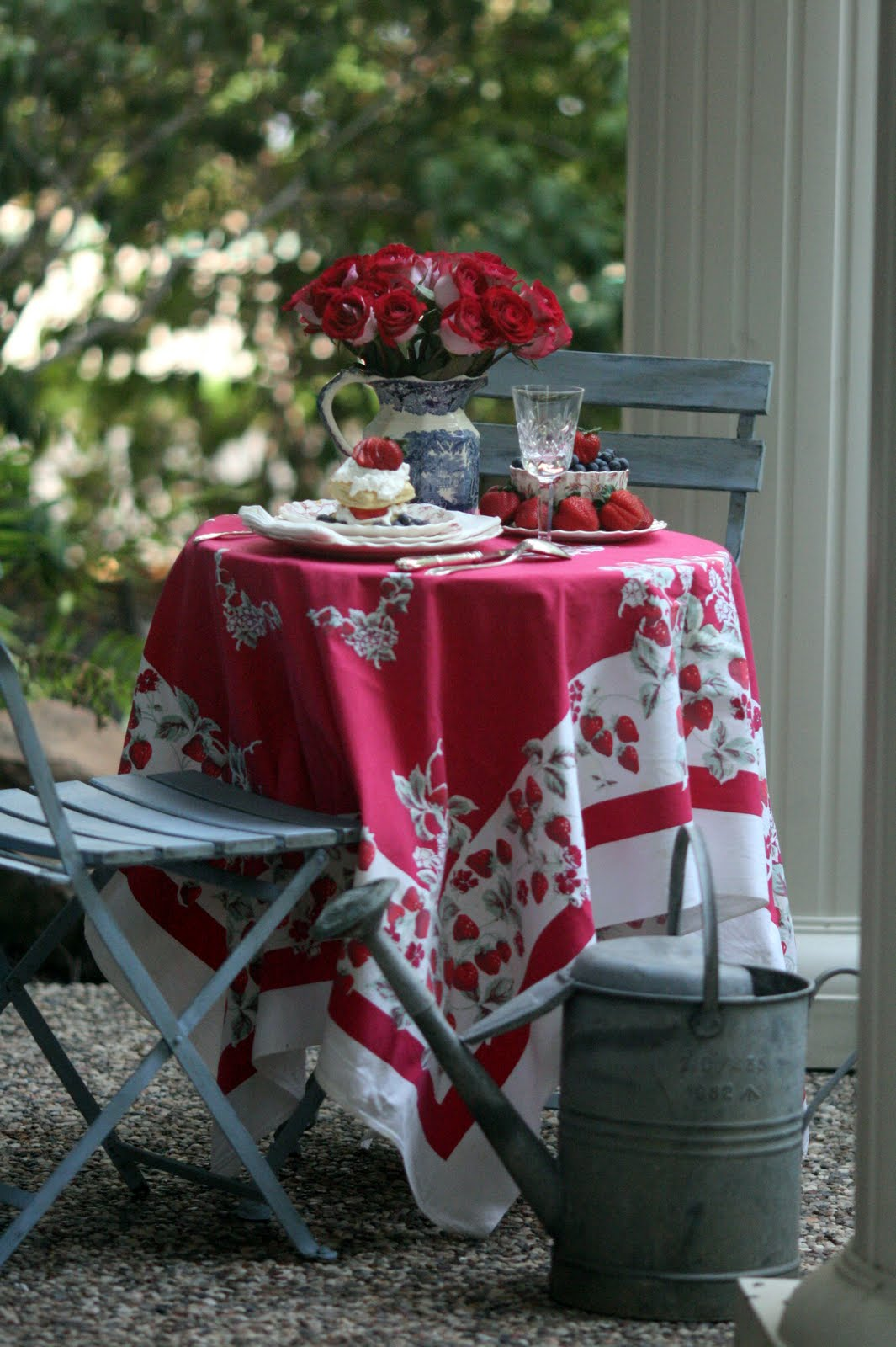Strawberry Napoleons, vintage tablecloth and watering can