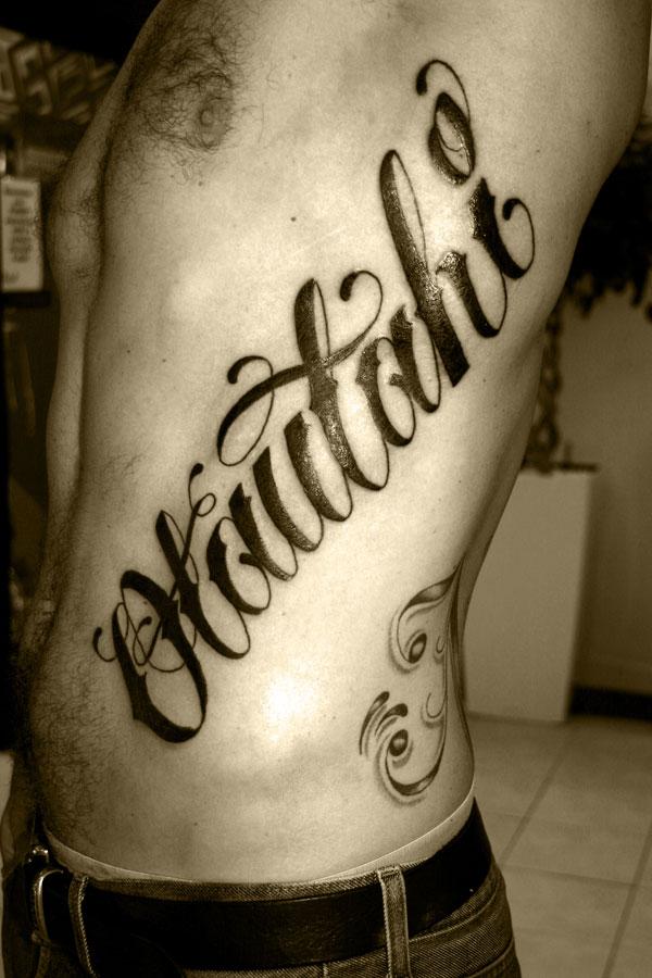 writing tattoos on ribs